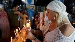 """كنيس """"الغريبة"""" في جزيرة جربة التونسية خلال الموسم السنوي لزيارة المعبد. 22 مايوا/أيار 2019."""