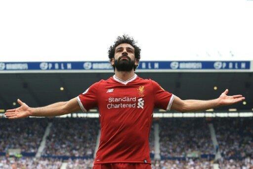 المصري محمد صلاح يحتفل بتسجيل هدف لناديه ليفربول في مرمى وست بروميتش ألبيون، ضمن مباراتهما في الدوري الإنكليزي الممتاز لكرة القدم، في 21 نيسان/أبريل 2018.