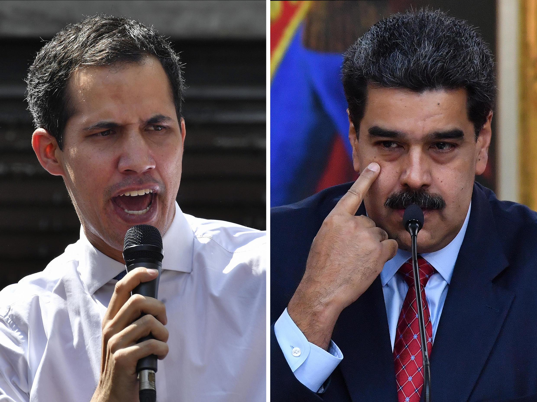 Venezuelan President Nicolas Maduro (R) has pardoned more than 100 lawmakers and associates of opposition leader Juan Guaido