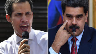 Venezuelan President Nicolas Maduro (R) has pardoned more than 100 lawmakers and associates of opposition leader Juan Guaido