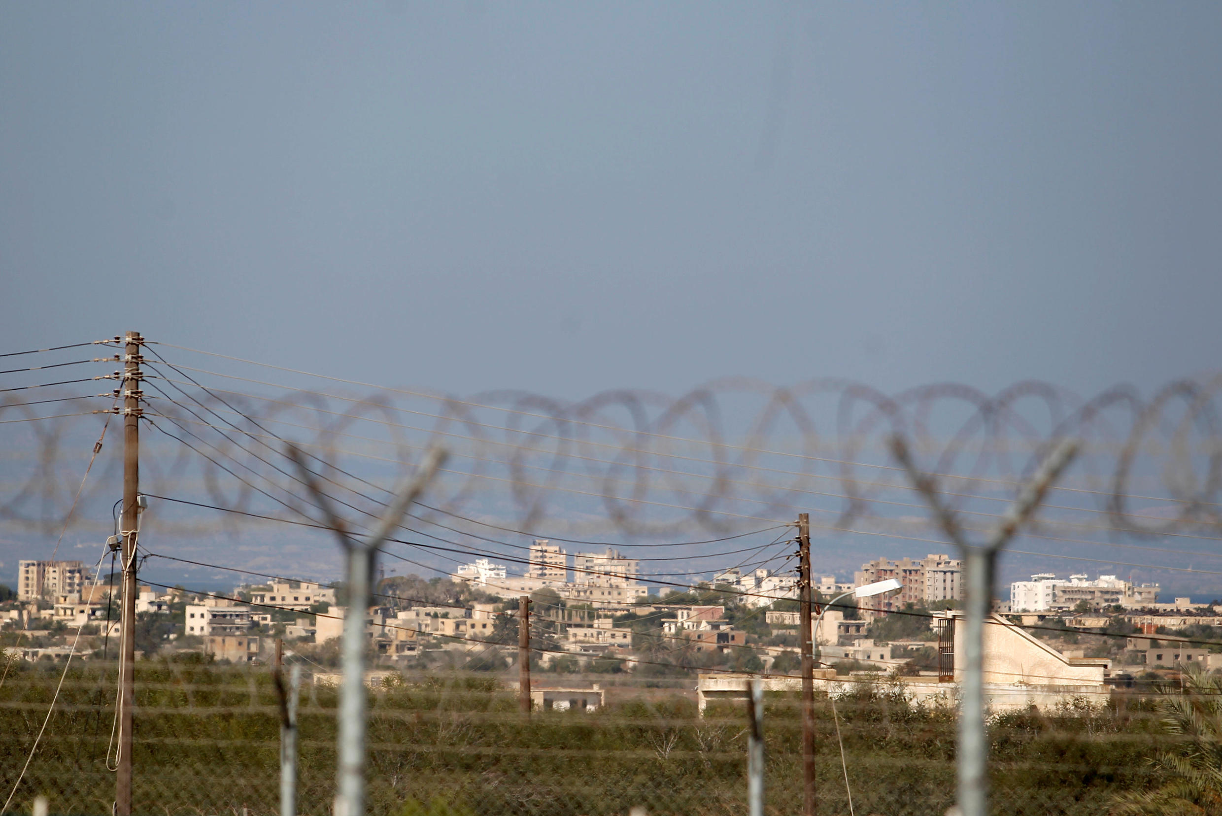 The fenced-off area of Varosha, restricted by the Turkish military, is seen from the Dherinia checkpoint on a ceasefire line, Cyprus, November 12, 2018.