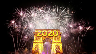 Fireworks illuminate the sky over the Arc de Triomphe during the New Year's celebrations on the Champs-Élysées in Paris, France on January 1, 2020.