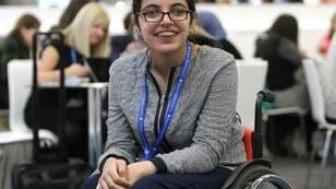 Nujeen Mustafa, a 20 year old Syrian with cerebral palsy, seen in 2016 in Frankfurt, Germany, where she traveled in a wheelchair with her family