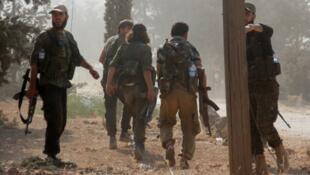 Des combattants de l'ex-Front al-Nosra, photographiés le 6 août 2016 aux alentours d'Alep.