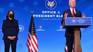 US President-elect Joe Biden (R), flanked by Vice President-elect Kamala Harris, delivers remarks at The Queen theater in Wilmington, Delaware on January 15, 2021.