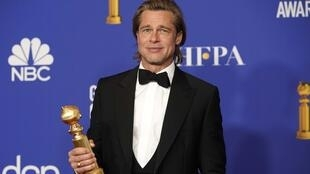 "77th Golden Globe Awards - Photo Room - Beverly Hills, California, U.S., January 5, 2020 - Brad Pitt poses backstage with his award for Best Performance by an Actor in a Supporting Role in any Motion Picture for ""Once Upon a Time...in Hollywood."""