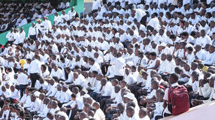 The stadium in Gitega where the funeral ceremony is to be held was packed with citizens from across the country, all dressed in white at the request of authorities