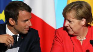 Emmanuel Macron et Angela Merkel au palais de l'Elysée, le 28 août 2017.
