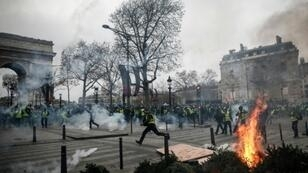 Protesters in Paris set fire to cars, burned barricades and smashed windows in pockets of violence, clad in their emblematic luminous safety jackets