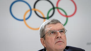 Thomas Bach admits there is no 'solution' at this point to the challenges posed by coronavirus to the postponed Tokyo Olympics