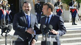 Le président français Emmanuel Macron(à droite) et le Premier ministre libanais Saad Hariri lors de son allocution à l'Élysée à Paris, le 20septembre2019.