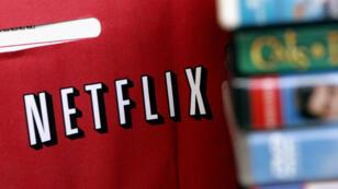 En esta foto de archivo del 16 de enero de 2007, se muestra un anuncio de devolución de Netflix en Miami, Florida.