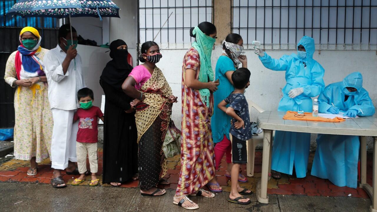 Medical personnel take temperatures during a Covid-19 health campaign in Mumbai on July 4, 2020.