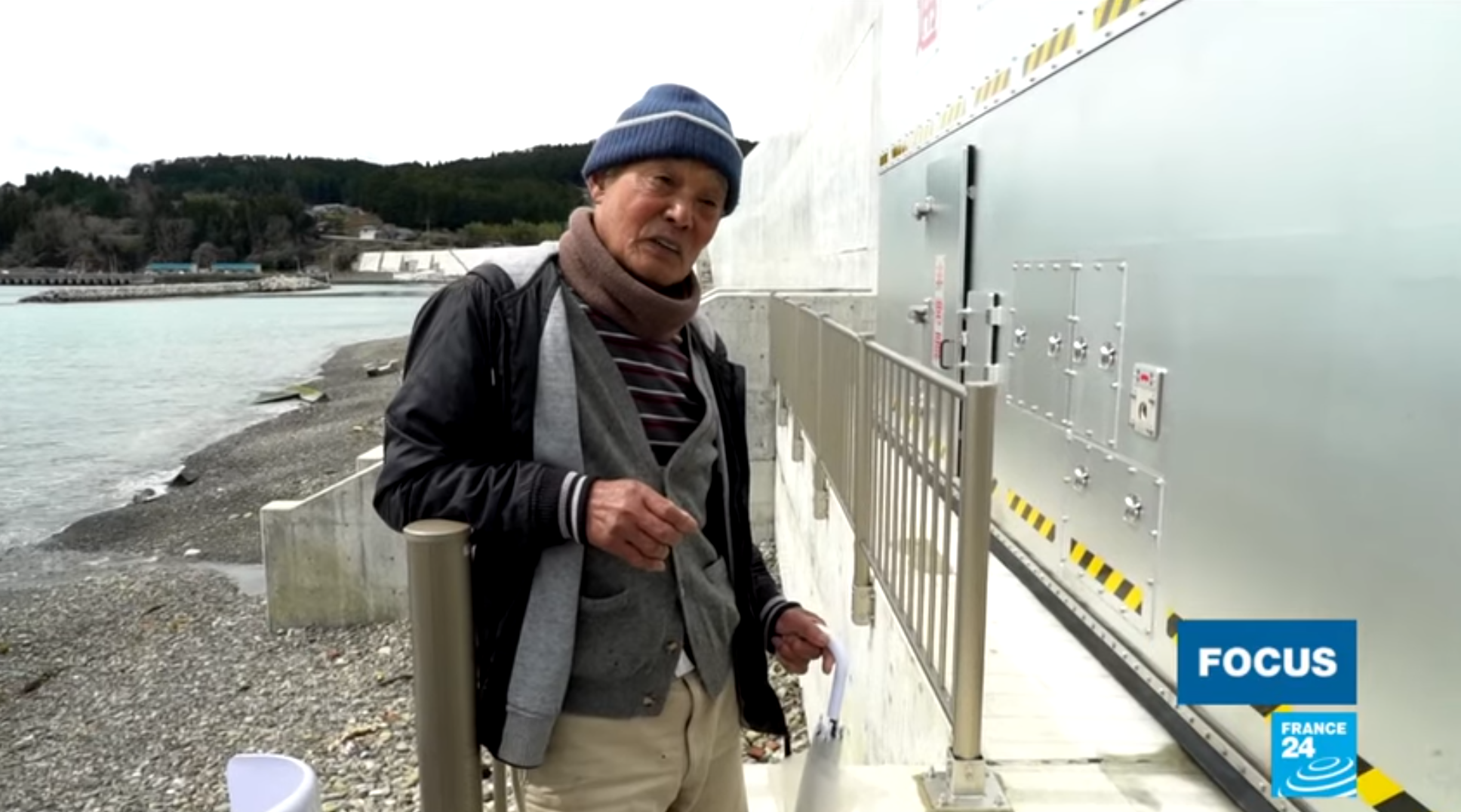 A local resident explains how the 'great wall' of Japan works.