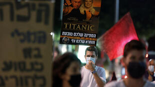 Israeli anti-government protesters demonstrate against an unpopular coronavirus lockdown reportedly violated by high-profile figures