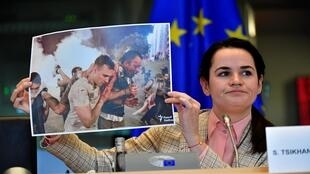 Belarus opposition leader Svetlana Tikhanovskaya holds up a photograph as she addresses members of the EU parliament at the EU headquarters in Brussels on September 21, 2020.