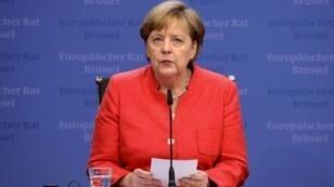 المستشارة الالمانية أنغيلا ميركل في مؤتمر صحافي في 29 من حزيران/يونيو 2018