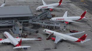 An aerial view shows Colombian airline Avianca's planes parked at El Dorado International Airport in Bogota, Colombia, on April 7, 2020, amid the coronavirus disease (Covid-19) outbreak.