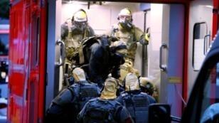 صورة التقطت في 12 حزيران/يونيو 2018 تظهر عناصر من وحدة خاصة في الشرطة الالمانية في مدينة كولونيا في غرب ألمانيا بعد العثور على مواد سامة في داخل شقة رجل تونسي
