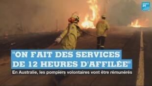 Des pompiers volontaires luttant contre les feux de brousses, dans l'État de la Nouvelle-Galles-du-Sud.
