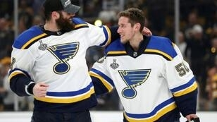 Pat Maroon (left) and goaltender Jordan Binnington of the St. Louis Blues celebrate after defeating the Boston Bruins in game seven of the NHL Stanley Cup final