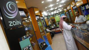 The logo of Kuwait's telecom company Zain is displayed at a store in Kuwait City