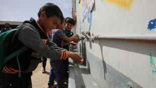 Syrian refugee students take part in a hand-washing activity as part of an awareness campaign about the novel coronavirus initiated by Oxfam and UNICEF at the Al Zaatari refugee camp in the Jordanian city of Mafraq, near the border with Syria, on March 11, 2020.