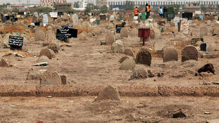 Members of a forensic team at a first mass grave found south of Khartoum in June