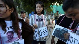 Une manifestation de soutien aux journalistes de Reuters emprisonnés en Birmanie, Wa Lone et Kyaw Soe Oo, à Rangoun, le 16septembre2019.
