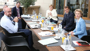 President of the European Council Charles Michel (L), Germany's Chancellor Angela Merkel (C), France's President Emmanuel Macron (2nd R) and President of the European Commission Ursula von der Leyen pose during a meeting at the first face-to-face EU summit since the coronavirus disease (COVID-19) outbreak, in Brussels, Belgium July 19, 2020.