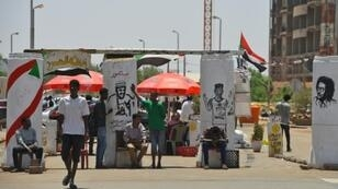 Sudanese graffiti artists commemorate five protesters shot dead at a longrunning sit-in outside army headquarters overnight in what protest leaders charged was a bid to derail talks with the country's military rulers