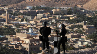 Algerian security forces stand guard on a ridge looking down on the Algerian city of Ghardaia on March 18, 2014, during an operation to secure the city following sectarian clashes.