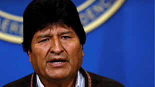 Bolivia's President Evo Morales addresses the media at the presidential hangar of the Bolivian Air Force terminal in El Alto on November 10, 2019.