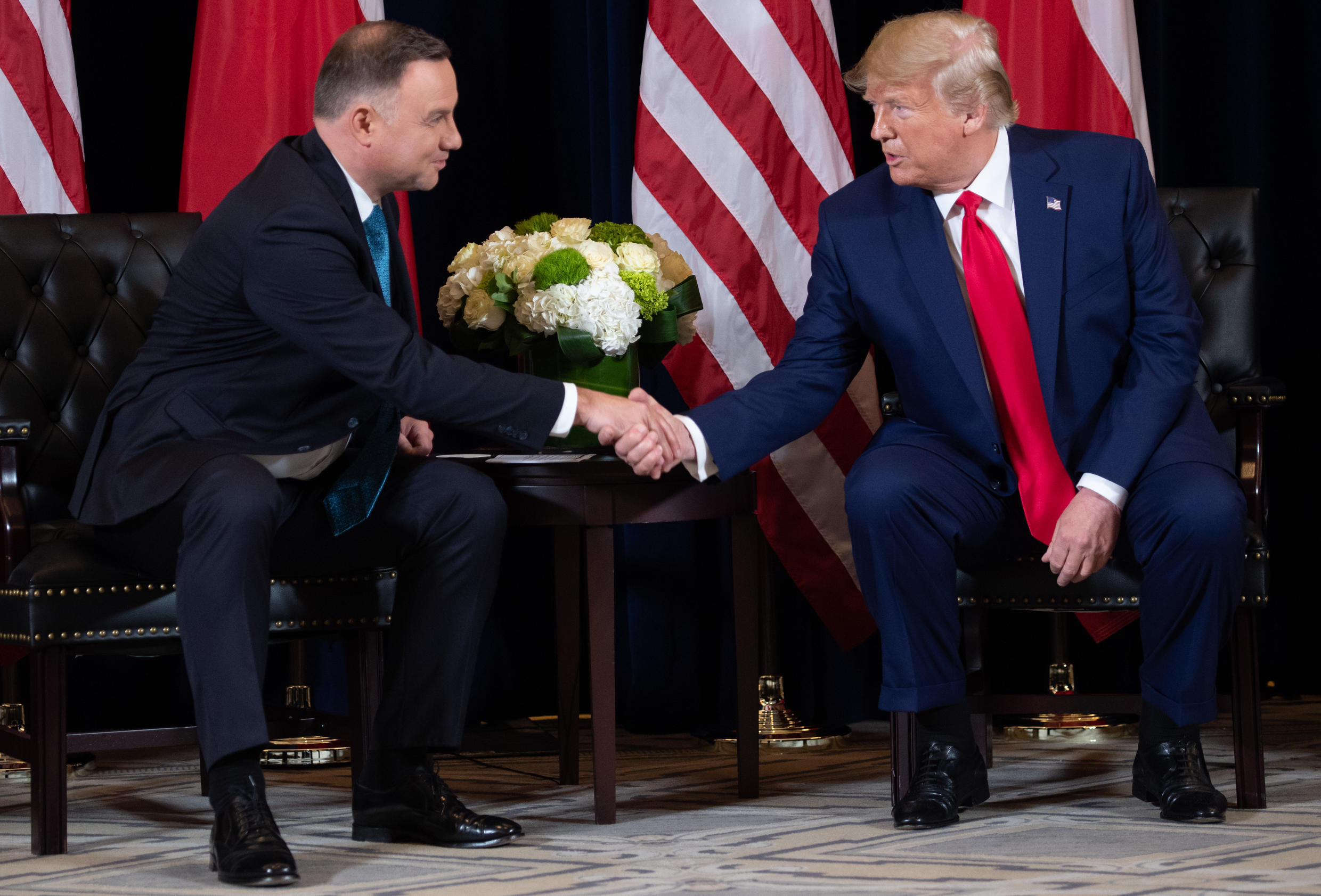 US President Trump shakes hands with Polish President Duda in New York in September 2019. Duda is visiting Washington four days before a crucial election in Poland