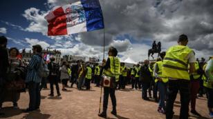 متظاهرون في مدينة ليون في السبت الـ26 لاحتجاجات السترات الصفراء 11 أيار/مايو 2019