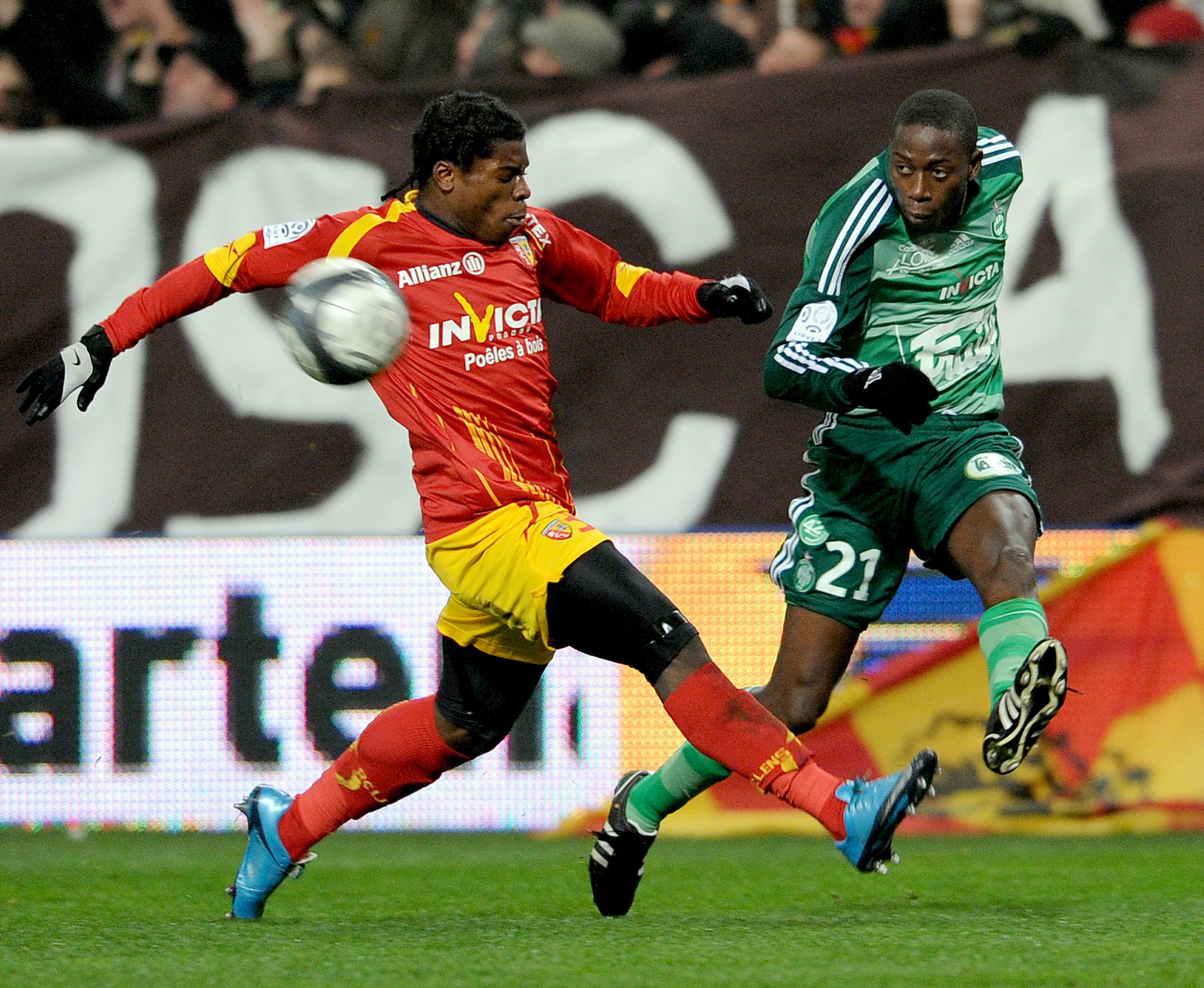 In this December 22, 2009 photo, Lens defender Christopher Aurier (L) vies with Saint-Etienne midfielder Mouhamadou Dabo during a French L1 football match at Felix Bollaert Stadium in Lens, France.