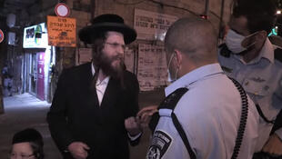 Israeli police officers are often verbally or physically abused when they enter the ultra-orthodox neighbourhood in Jerusalem to ensure the population there respects the government's lockdown rules.