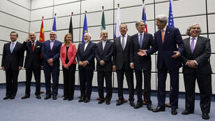 Diplomats gathered in Vienna pose for a group photo after announcing a long-awaited deal on Iran's nuclear programme on July 14.