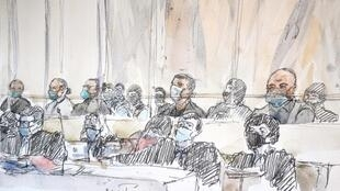 Some of the accused in the courtroom watched the images, while others looked away