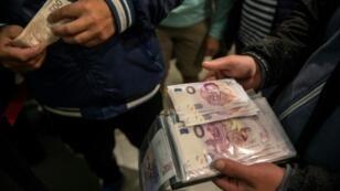 "A man showed off his newly acquired ""Zero Euro"" souvenir banknotes depicting Czech pop singer Karel Gott"