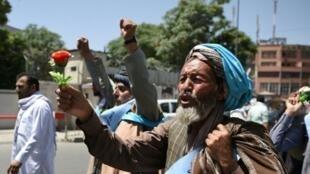 أفغان يدعون لتمديد الهدنة بين الحكومة وطالبان، 18 حزيران/يونيو 2018.