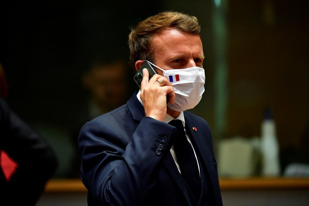 French President Emmanuel Macron speaks on the phone during an EU summit in Brussels on July 20, 2020.