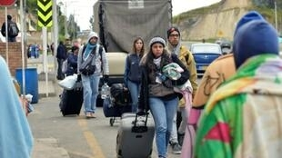 Venezuelans head towards the border in August, when about about 18,000 people were leaving the country every day