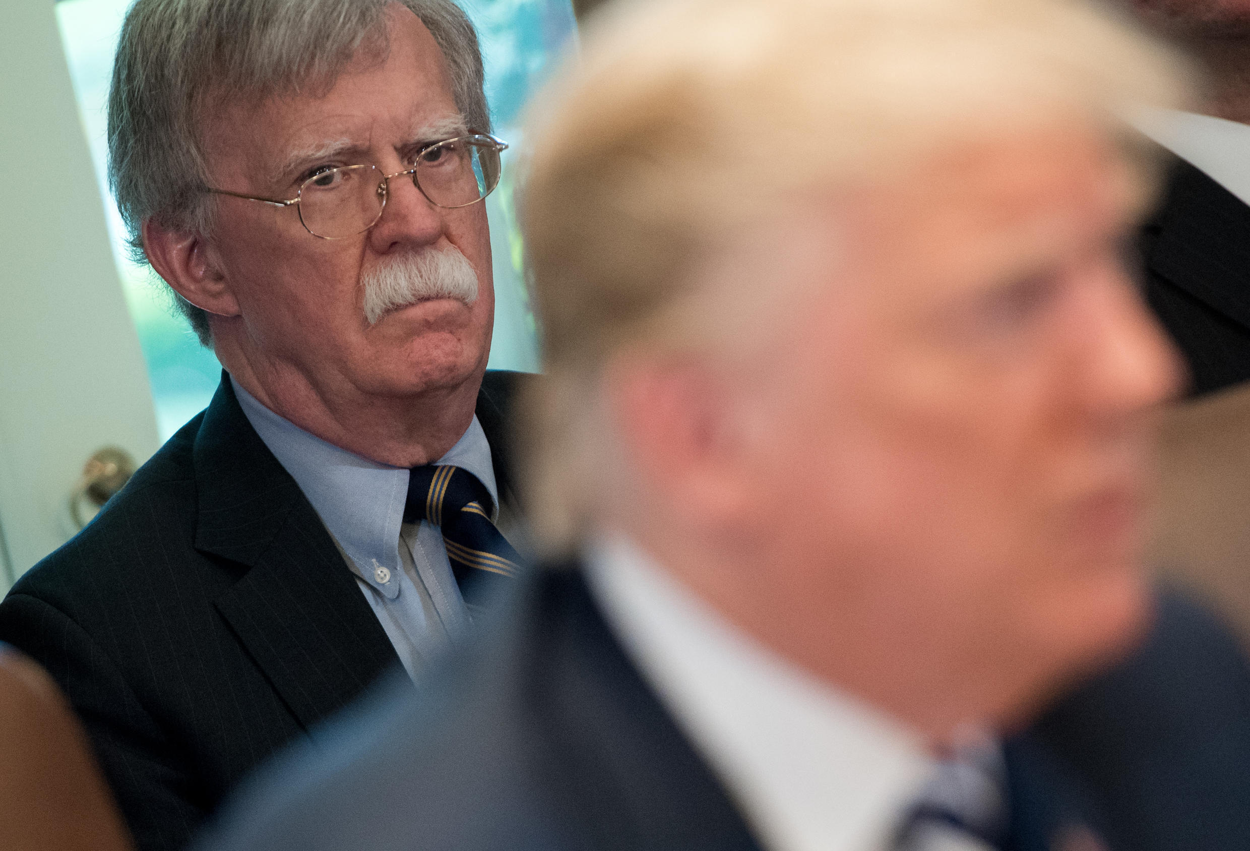 In this file photo, US President Donald Trump speaks alongside then national security adviser John Bolton (L) during a cabinet meeting in the White House in Washington, DC on May 9, 2018.
