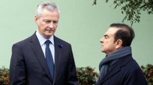 Bruno Le Maire et Carlos Ghosn attendant Emmanuel Macron pour visiter l'usine Renault de Maubeuge, le 8 novembre 2018.