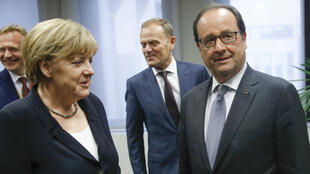 French President Francois Hollande (R), German Chancellor Angela Merkel (L) and European Council President Donald Tusk (C) arrive at the European Union (EU) headquarters in Brussels on July 7, 2015.