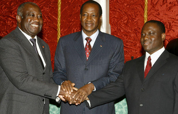 Gbagbo shakes hands with rebel chief Guillaume Soro (right) and Burkina Faso leader Blaise Compaore (centre) in March 2007 before signing a peace deal to end years of civil war.