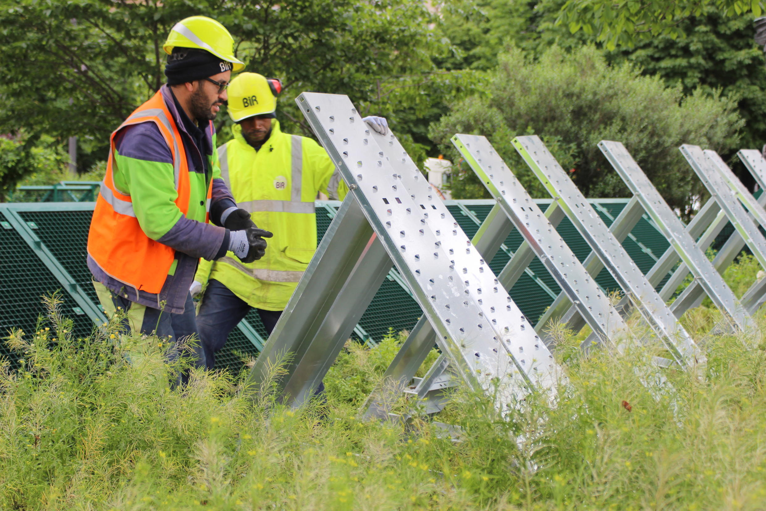 Workers rushed to set up anti-flood barriers to protect an electrical installation near Alma Bridge.