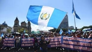 Demonstrators march against Guatemalan President Jimmy Morales in Guatemala City on January 12, 2019