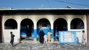 A health centre in northwest Pakistan torched by a mob following rumours of bad reactions to a polio vaccination